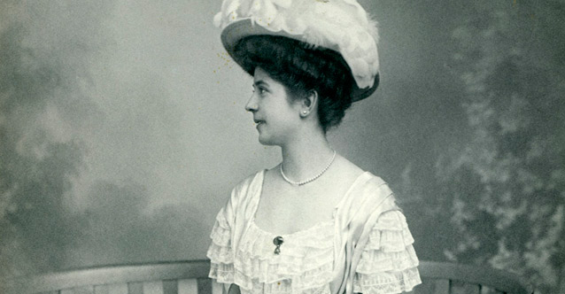 A Picture of Yooung Lady with a Big Hat and White Dress Probably at the end of 19th Century